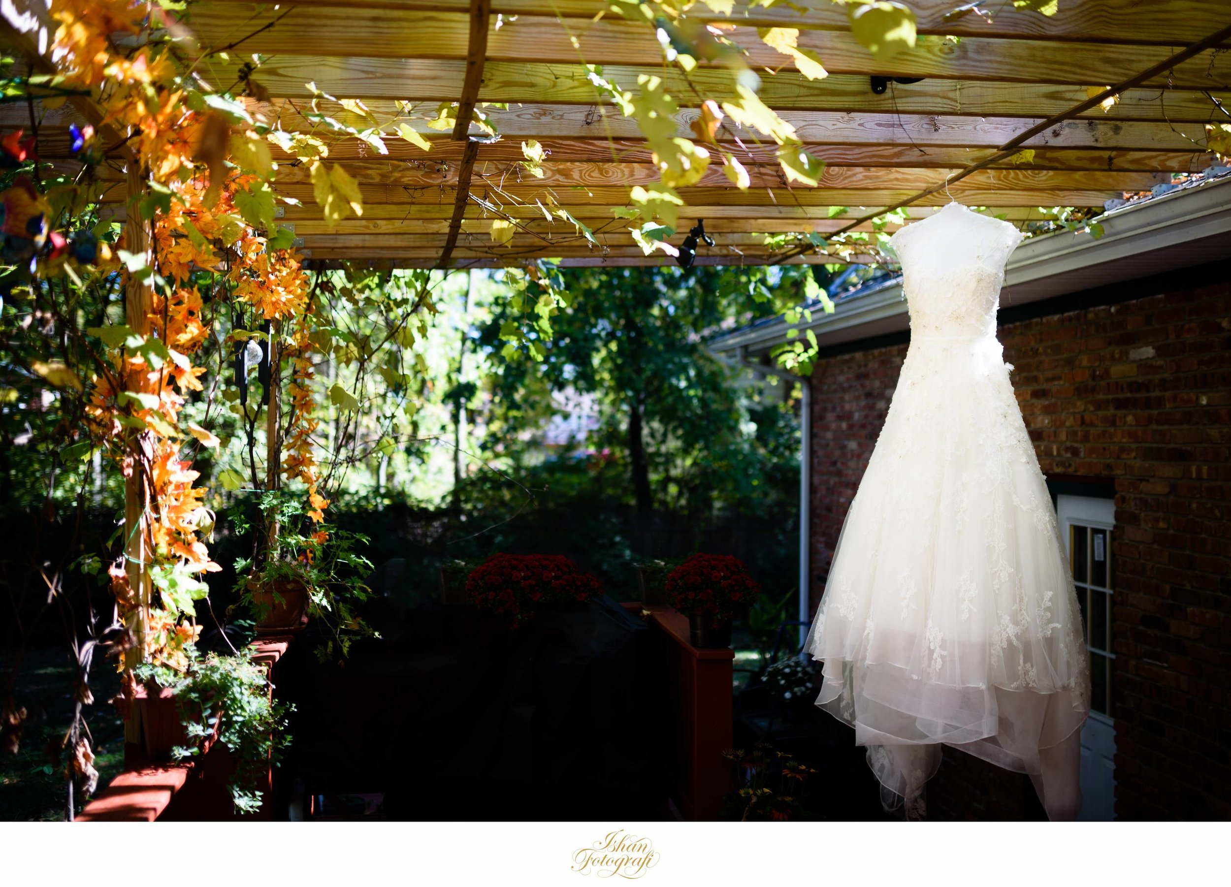 Our bride's gorgeous Elie Saab wedding gown in their backyard. Their backyard was beautifully decorated and full of foliage. We love when brides choose to get ready at their homes on their wedding day.