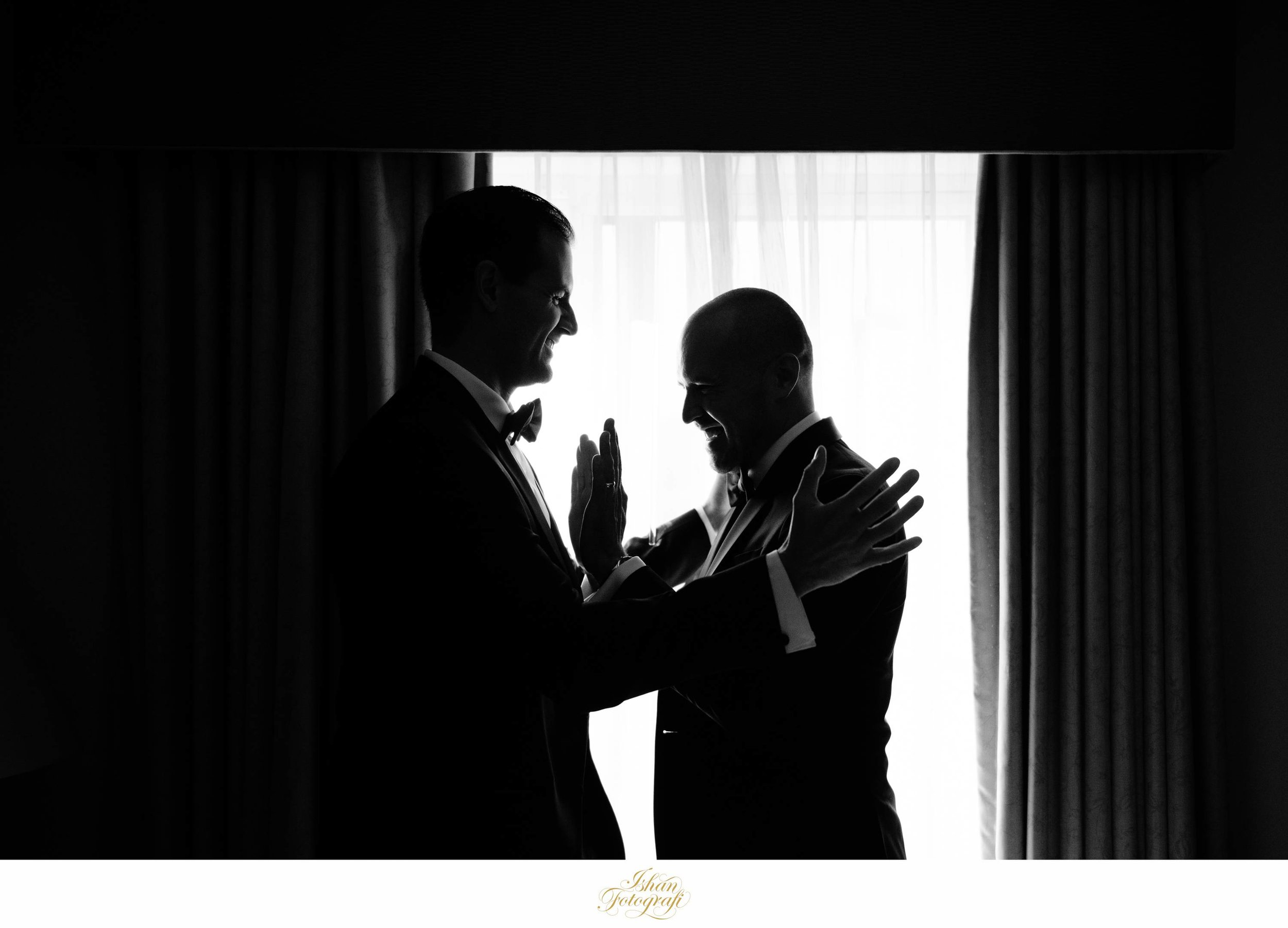 The groom and his best man sharing a laugh together. The groom had planned to get ready with his groomsmen at a hotel in North Bergen located close to The Waterside Restaurant which was their reception venue.