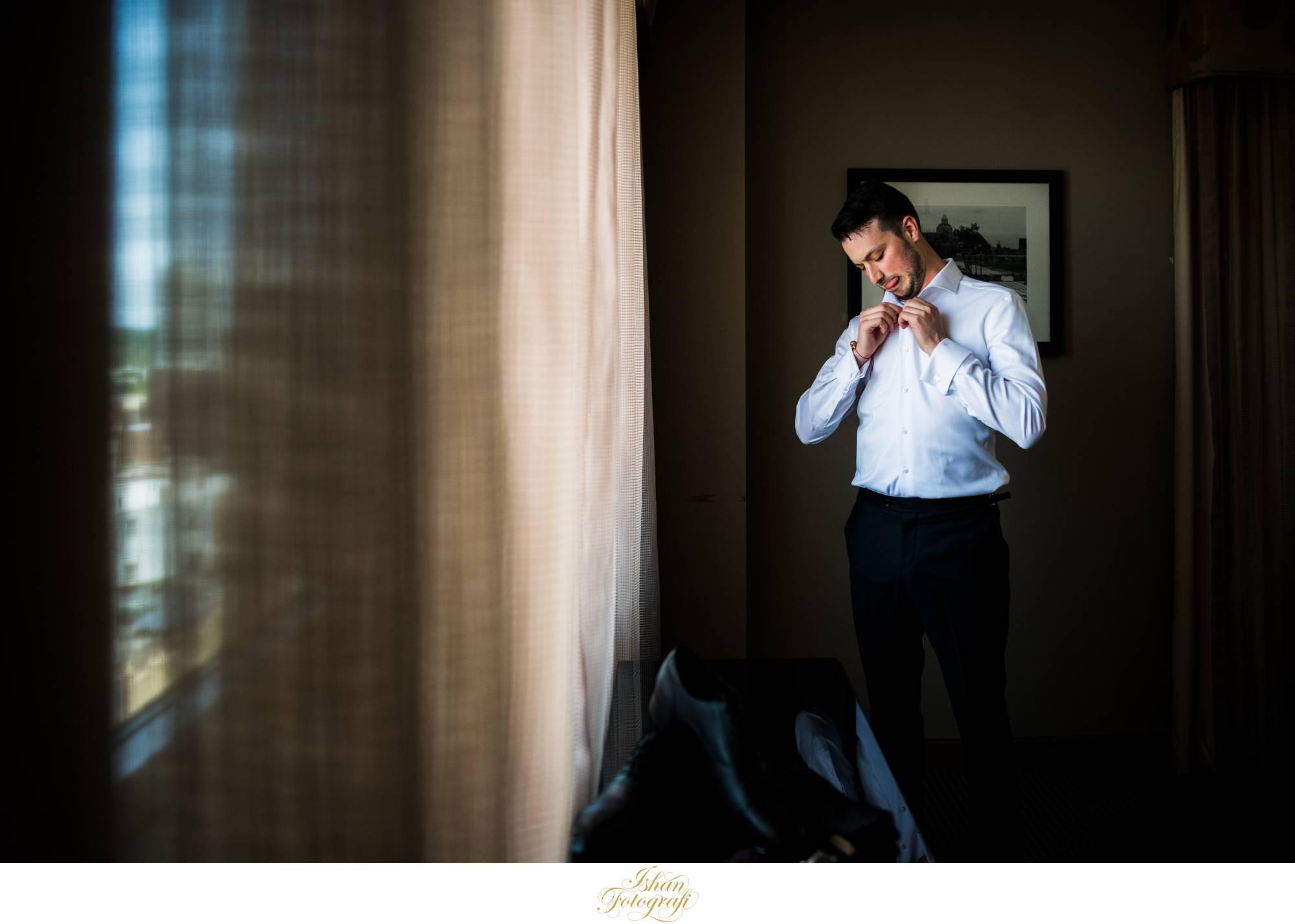 groom-getting-ready-the-heldrich-hotel
