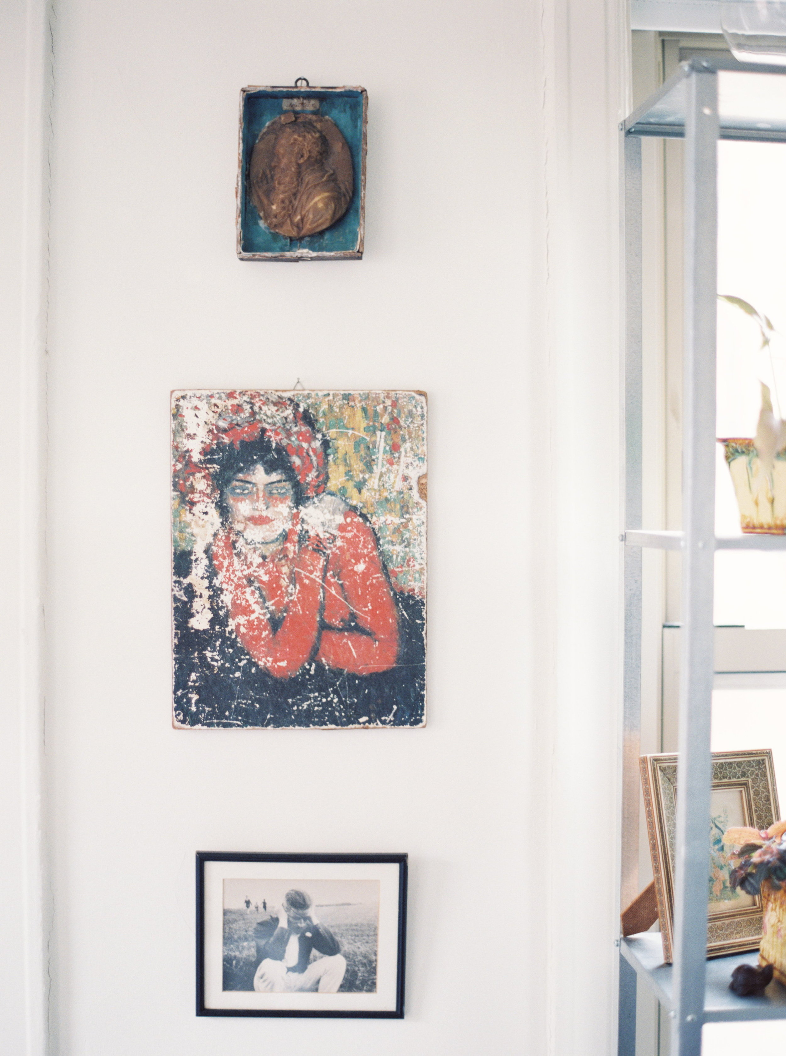 These three hang in my office, and each has a special spot in my heart. Thetop is a very old wax mold of Aristotle. I found it in a junk shop years ago and bought it forlike $1. That was before I went back to school for Philosophy. The middle painting is oneof my absolute favorite things. When I was in Athens, Greece in 2003 (a trip with Danieland friends) the trash collectors had gone on strike and so the streets were filled withtrash  and of course we all went digging around in it for treasures. We weren't the onlyones scavenging, there were some locals with wheelbarrows trash picking to try to resellthe goods. I saw this piece in one fella's wheelbarrow and convinced him to sell it to mefor 2 euro. I packed it around Europe and then home - totally worth it. The bottom photo isanother alltime favorite. I found it at Lakewood Antique Mart in the outside vendor area inboxes of junk set out for folks to pick through. I don't remember how much I paid for it, butit was cheap. I feel like it is perfect in my office, it captures my ever constant pensivemood when working. I didn't find out that it is a photo of James Joyce until one day in ameeting with one of my favorite philosophy professors at Temple University, KristinGjesdal - I was looking around her office and spotted the exact same photo on her bulletinboard and asked her about it. Somehow it became even more special after that.