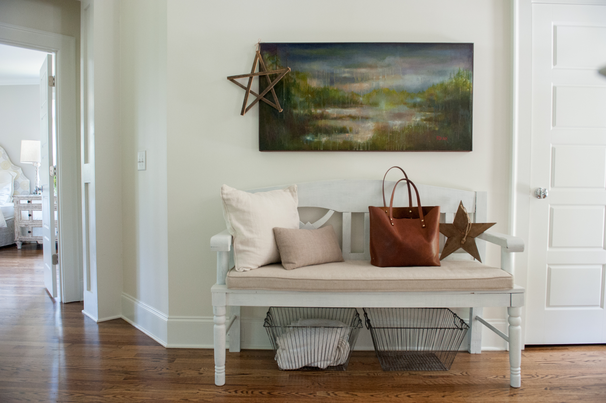 The painting in the entry was from a local artist and it's of the area around her parent's home in Canada.