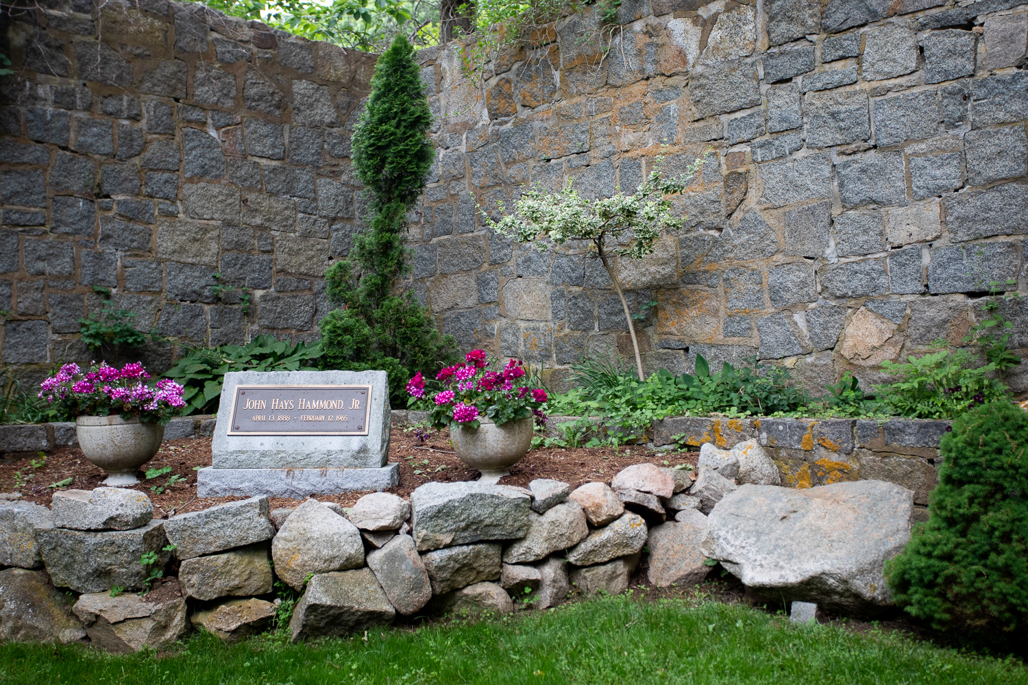 The final resting place of John Hays Hammond, Jr, located in front of the castle.It is said that poison ivy covers the site because Mr. Hammond did not want to be disturbed in his death.