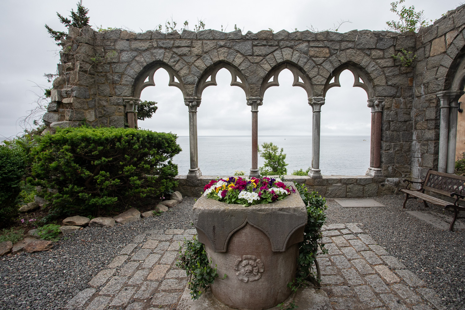 Near the main entrance to Hammond Castle. In the distance is the Atlantic Ocean.