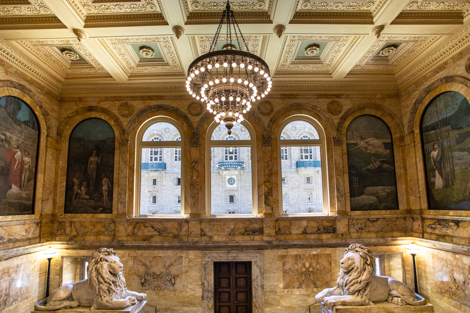 The lion sculptures in front of the grand staircase in the Boston Public Library.