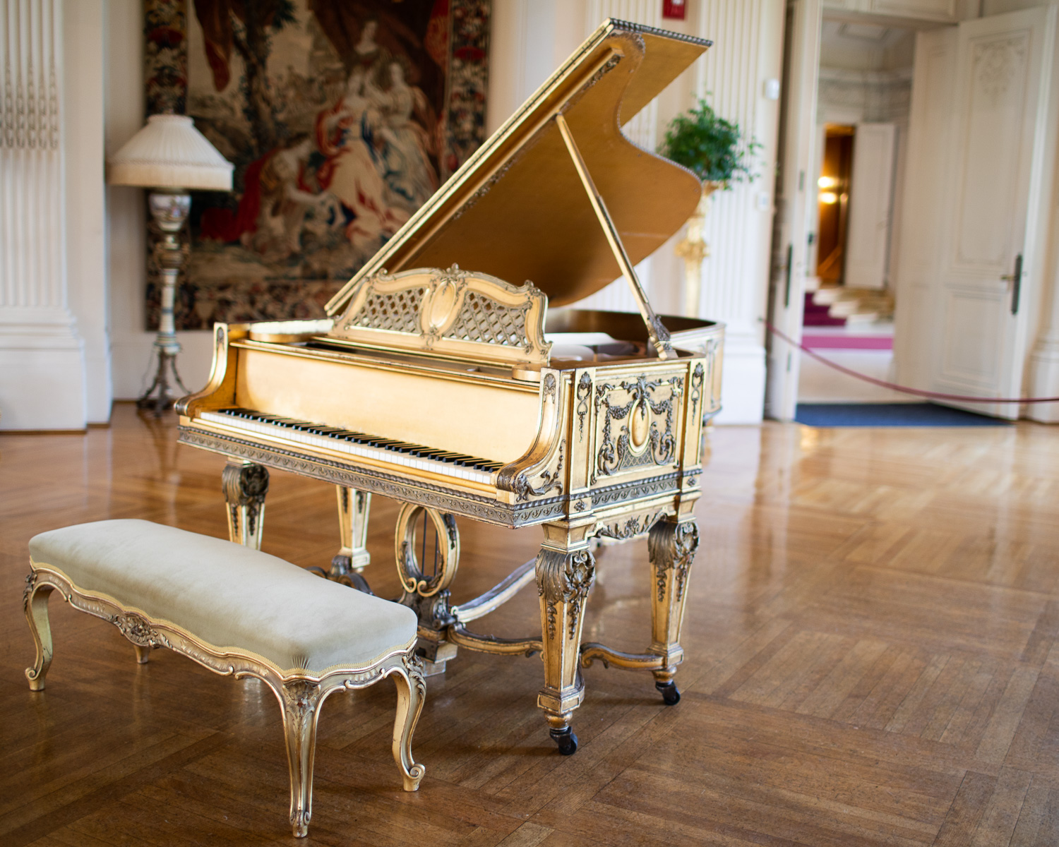 A grand piano in the ballroom.