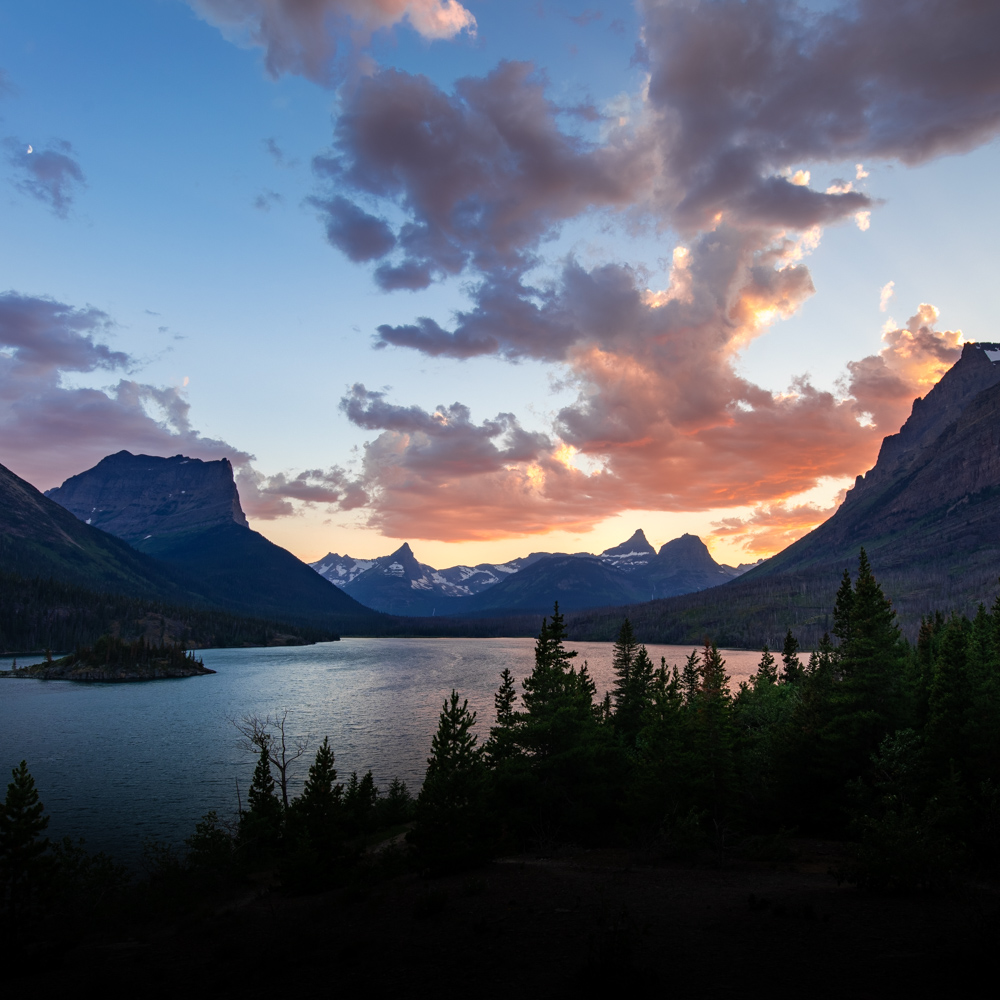 Sunset over St. Mary Lake at Glacier National Park. Note the crescent moon in the upper left corner.