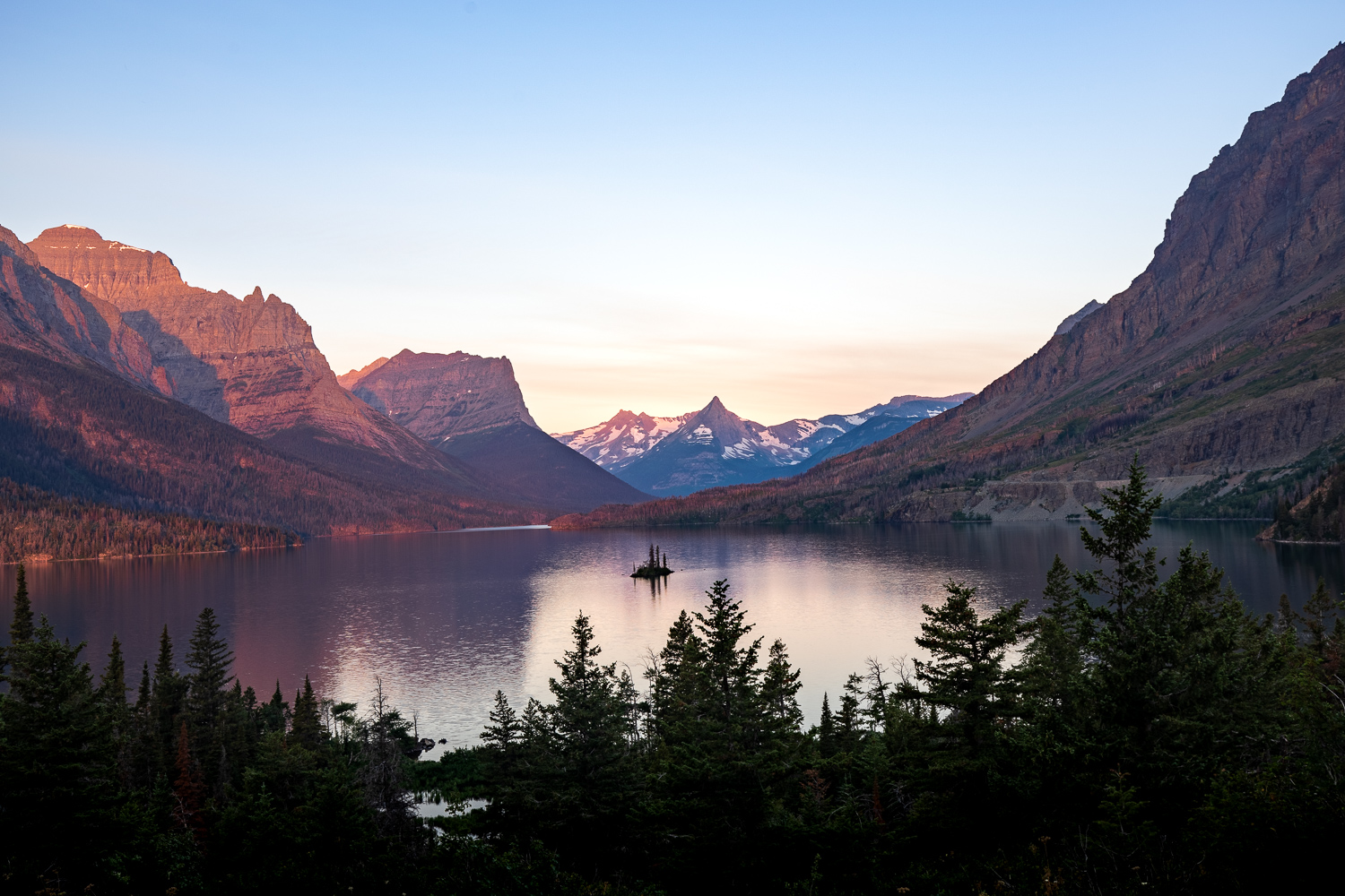 Sunrise over St. Mary Lake. Wild Goose Island is visible at the center of the lake.