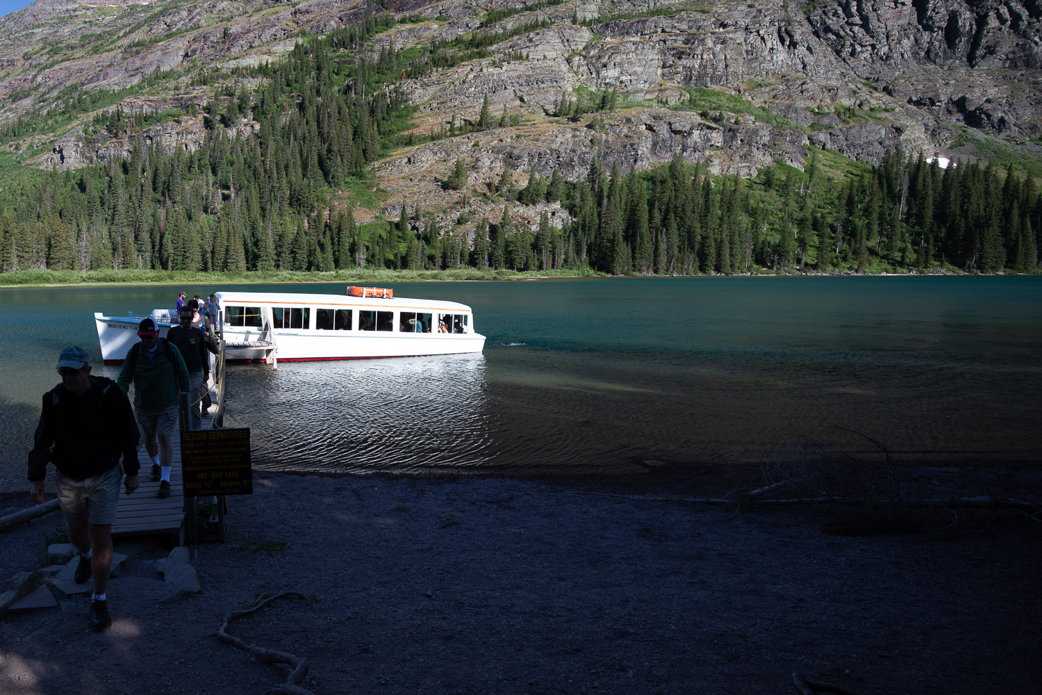Passengers departing the Morning Eagle on their way to traverse the Grinnell Glacier trail.