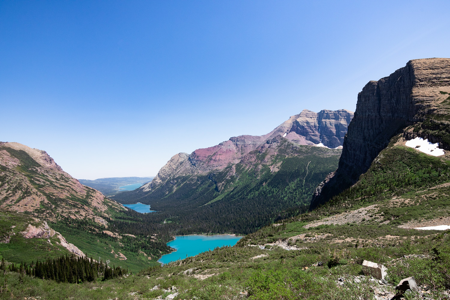 A view of Grinnell Lake, Lake Josephine, and Swiftcurrent Lake from the Grinnell Glacier trail.