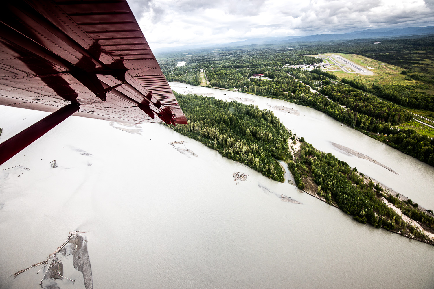 Shortly after take-off from the Talkeetna Airport ( TKA ). Note the airport in the upper right of the frame.