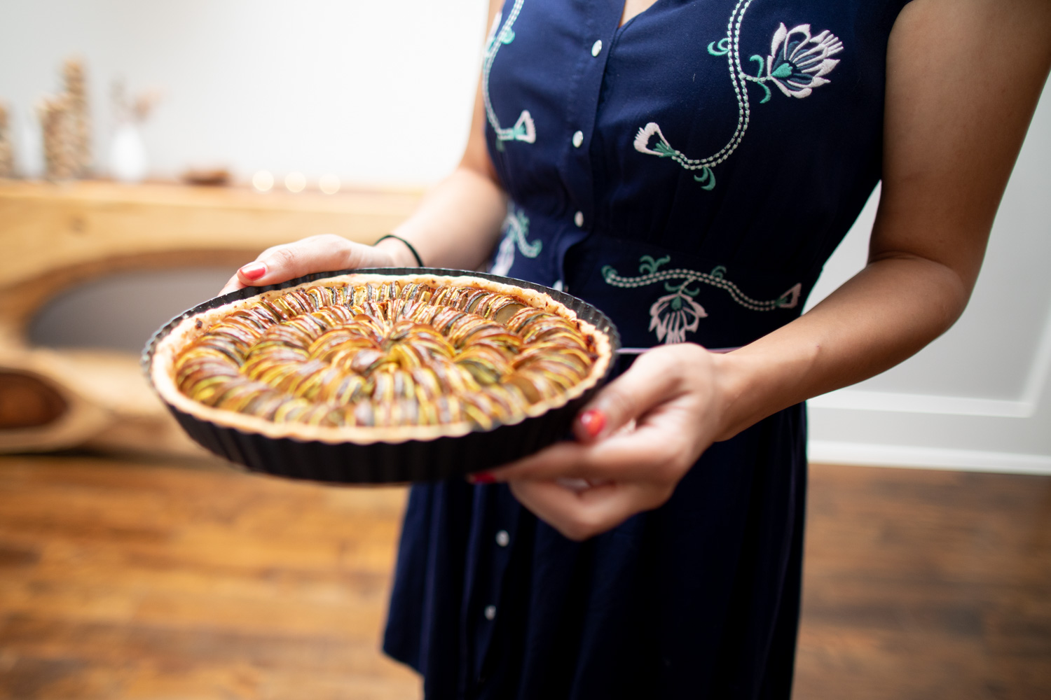 Ria serving the summer vegetable tarte.