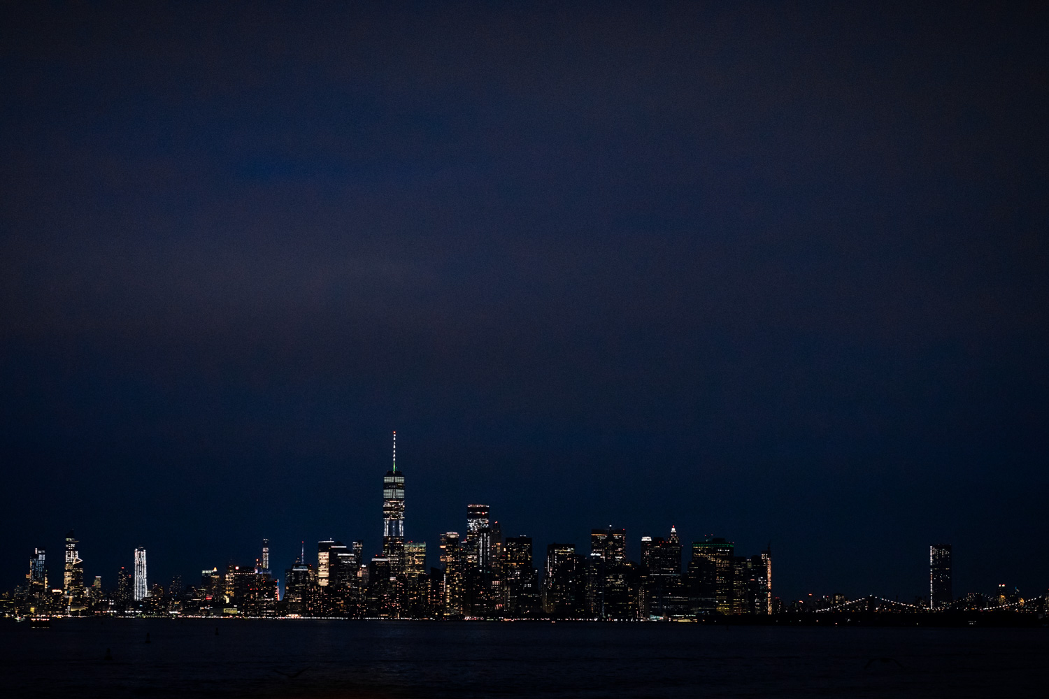 A view of Manhattan at night, as seen from the Staten Island Ferry.