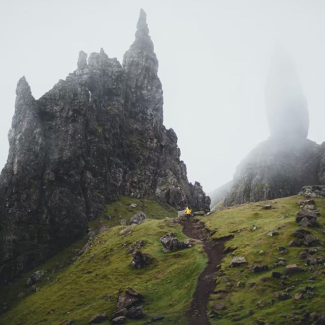 Traversing the moody landscape at the Old Man of Storr in Scotland... ⠀ As I mentioned in the previous post, the temperature and conditions here were very temperamental and subject to change quickly. In this capture, the fog moved in and about five minutes later the visibility was less than ten feet. ⠀ Oh, and that's Cath (@mydetoxtravel) in the frame, one of three instructors at the Scotland workshop. I encourage you to check out her incredible landscape work on Instagram and the web: https://www.cathsimard.com