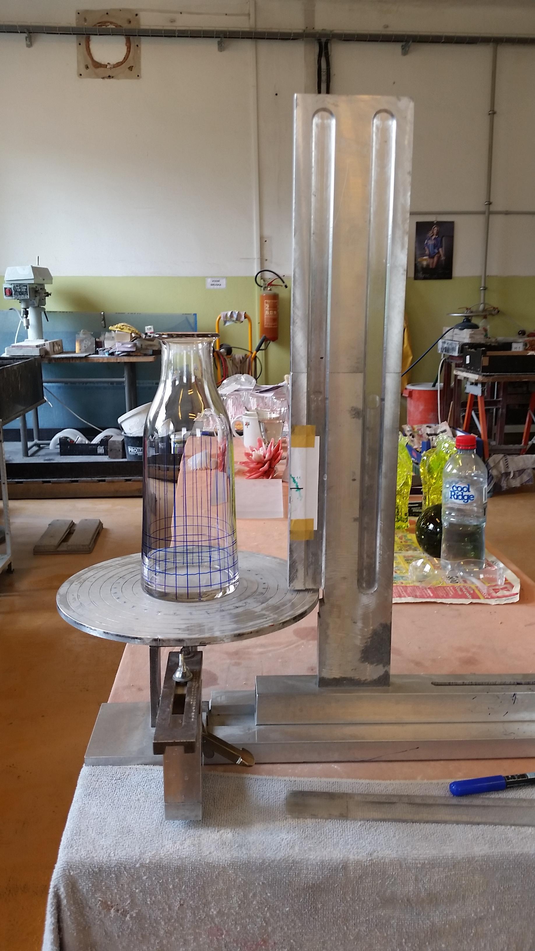 A mark making machine to prepare the glass