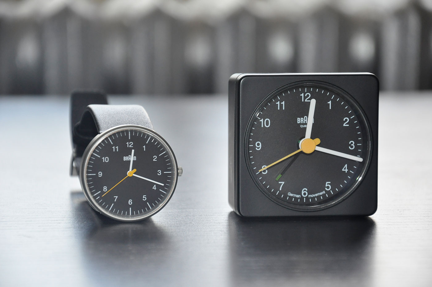 This is a side by side with the Braun alarm clock. We can easily see an immediate resemblance. The minute lines are longer on the hand watch, which is I like. I do wish that the hour/minute hands were slightly wider in size.