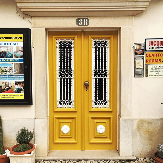 This yellow reminds me of the accent yellow of Braun from the past.  #door #portugal #yellow #albufeira #igers #iphone #symmetry #36