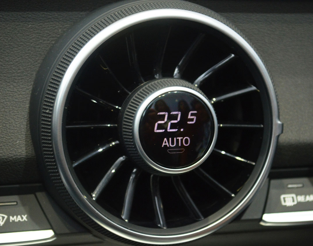 In the Audi TT, the air vent has a built-in climate control knob (the trigger). The knob also has a built-in display. Turning the knob controls the sets a temperature and also indicates the current temperature (the data).