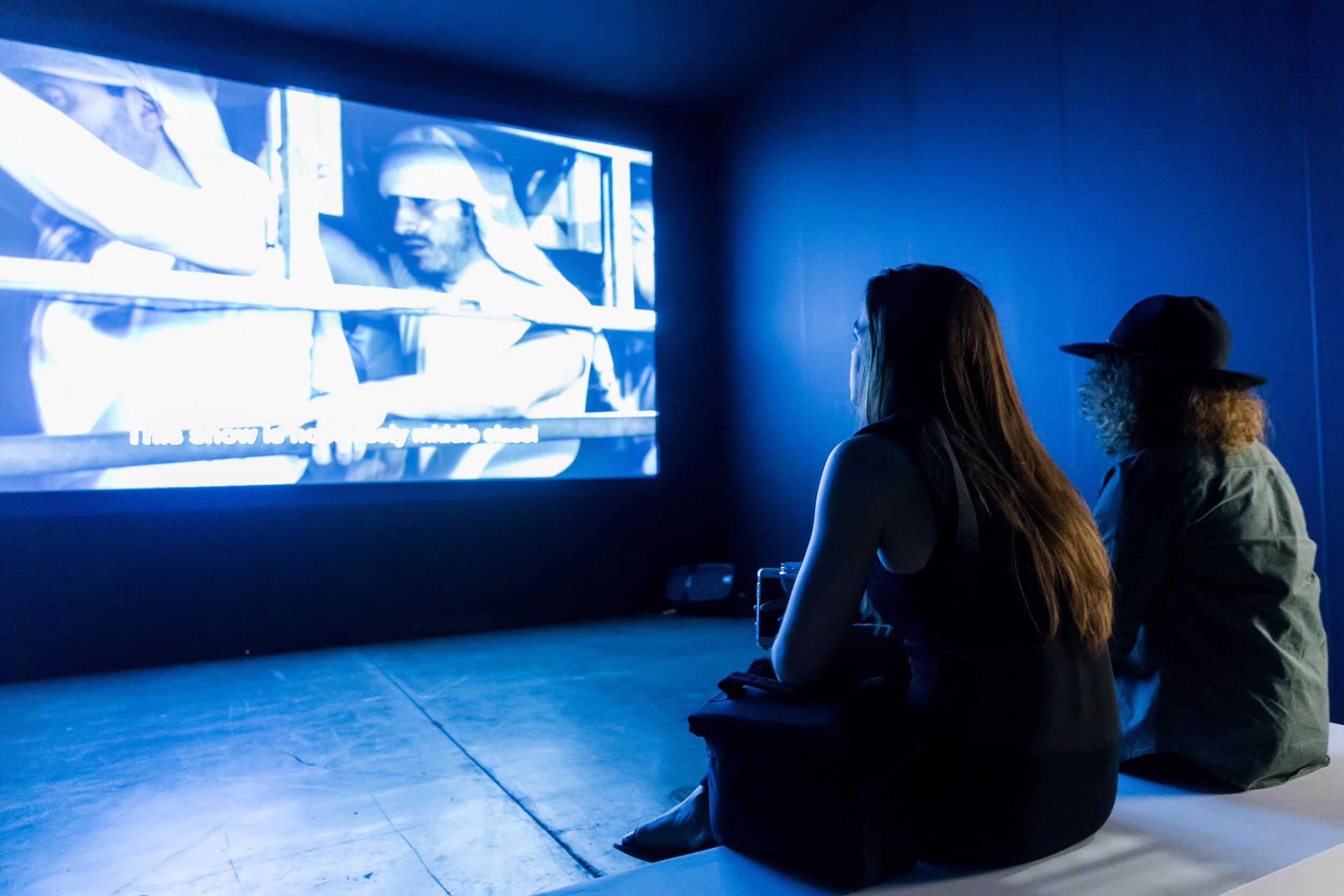 Art fair goers enjoying cinema @ Art Basel |Miami Beach 2015  © Art Basel