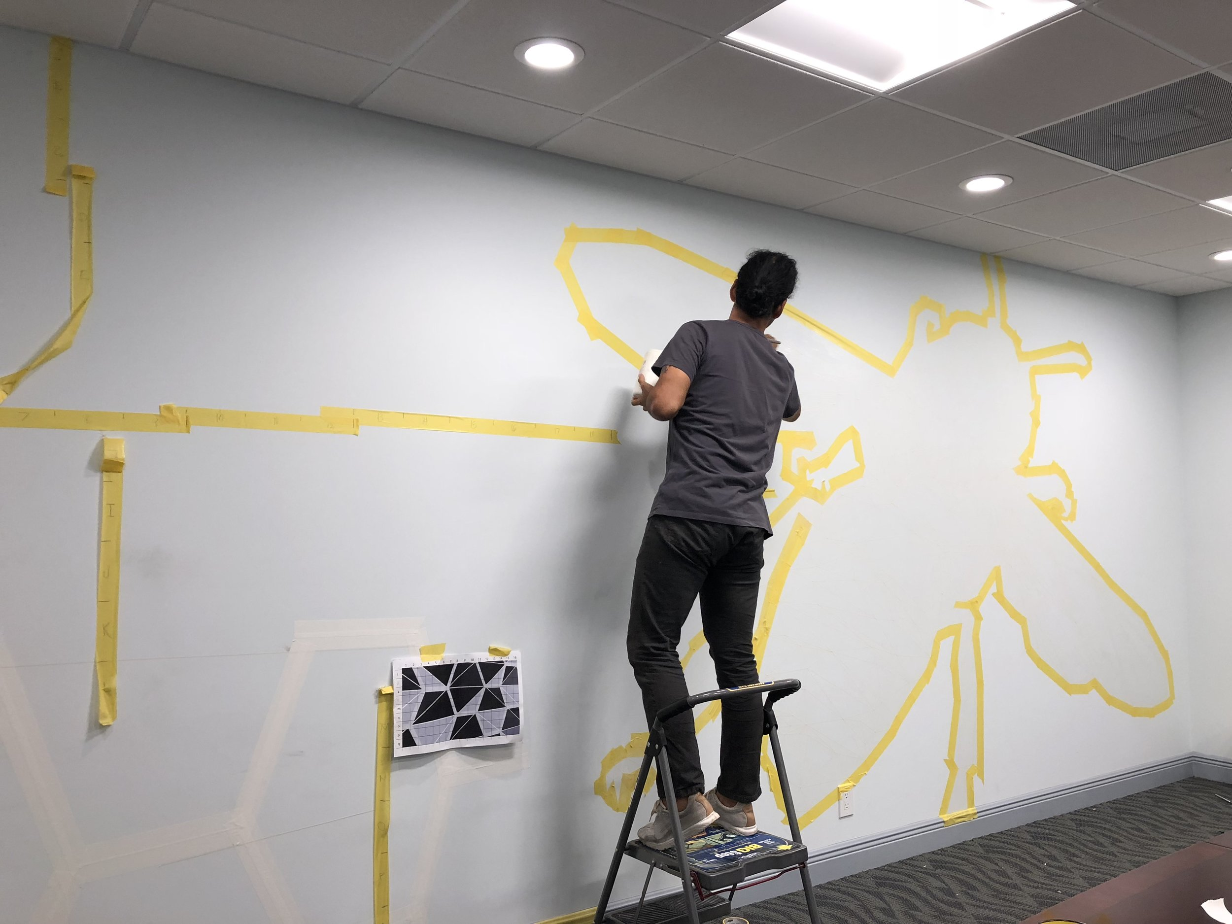 Jhonattan Arango  taping off his design in the conference room at Bee Access Products  in West Palm Beach.