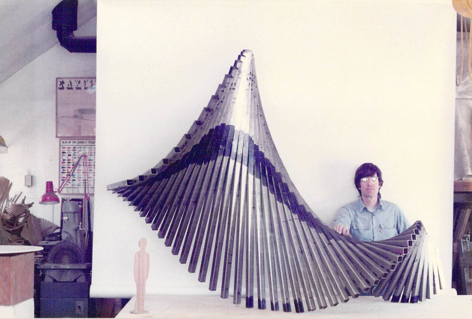 Artist with model of sculpture
