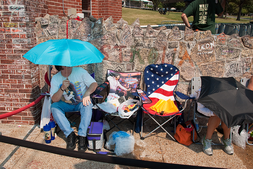 To be first in line at the gates to Graceland takes resiliency and an umbrella.