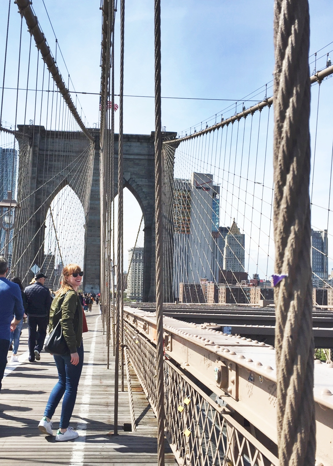 Oh hey guys, that's me, just casually turning my head towards my pal  Alison , who snapped the photo on the Brooklyn Bridge last April. Sometimes you just HAVE to be a tourist.