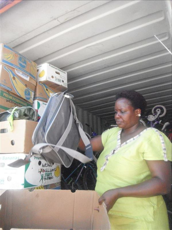 Esther M. unpacking the provisions that arrived to Clover from the U.S.