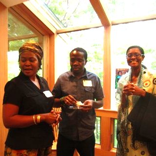 lover past President, Salma Semakula, greeting guests at Clover's first event to raise awareness.