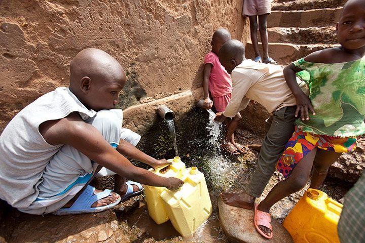 children at water spout.jpeg