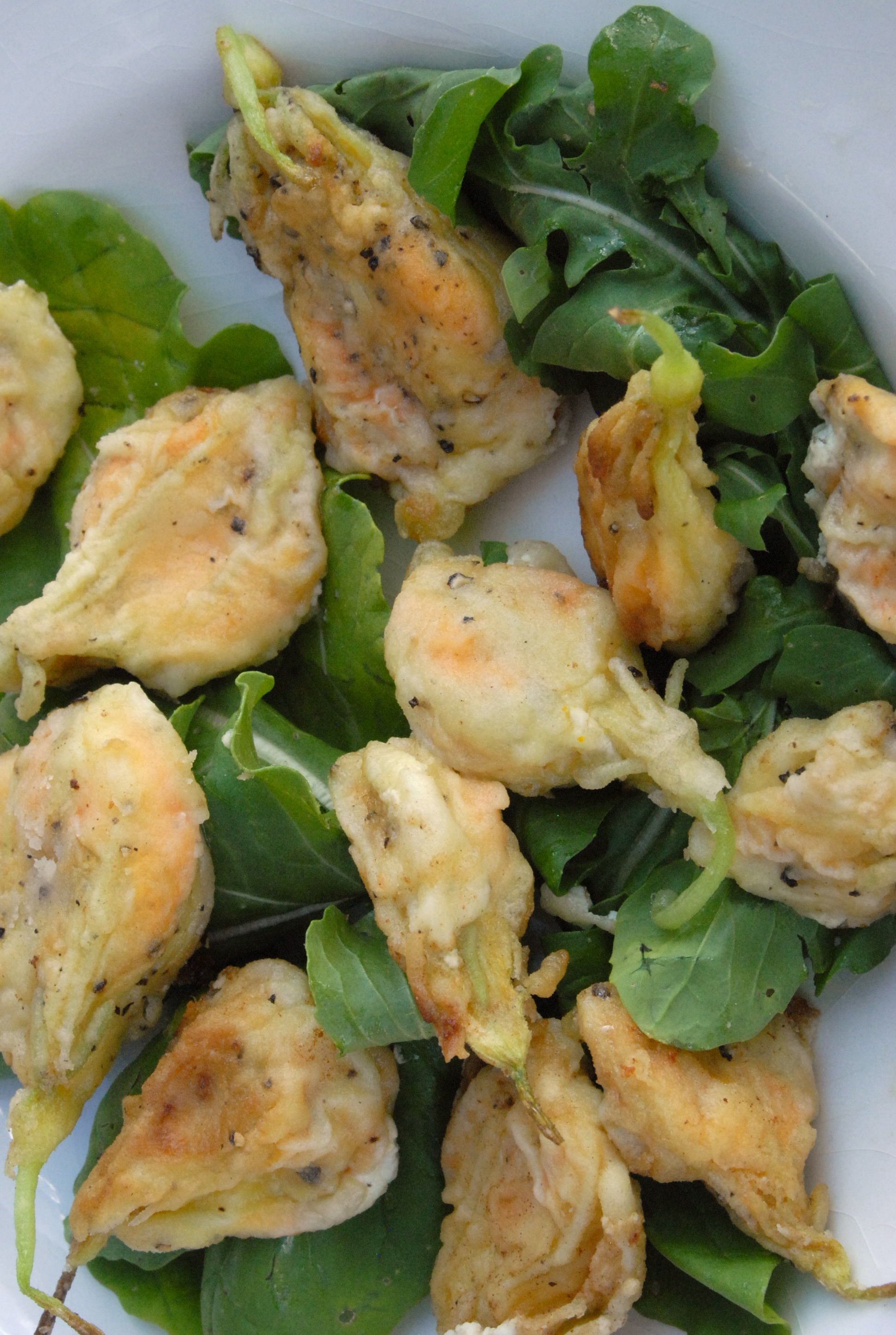 sauteed sqash blossoms on arugula.jpg