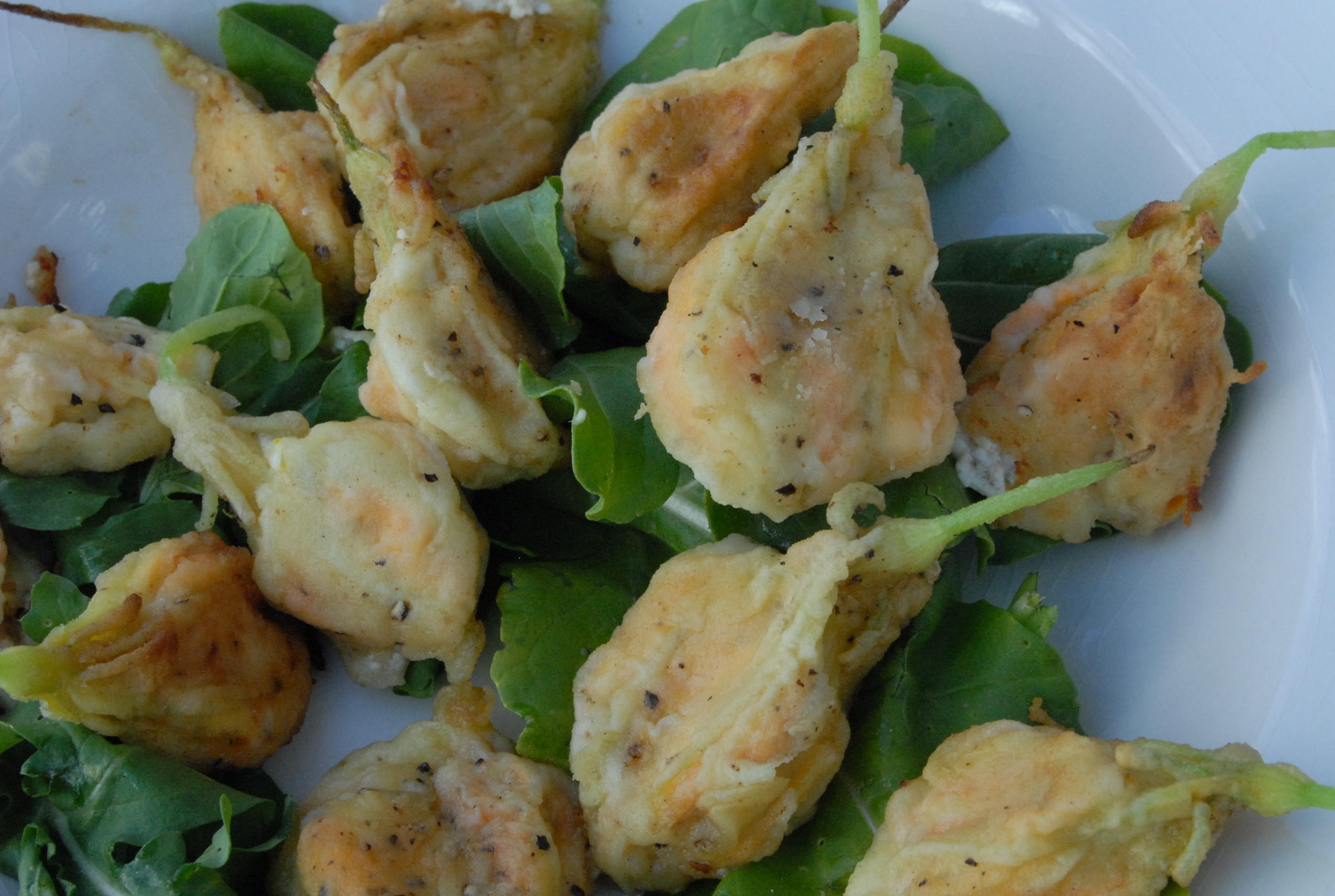 Sauteed Squash Blossoms Stuffed w/Goat Cheese