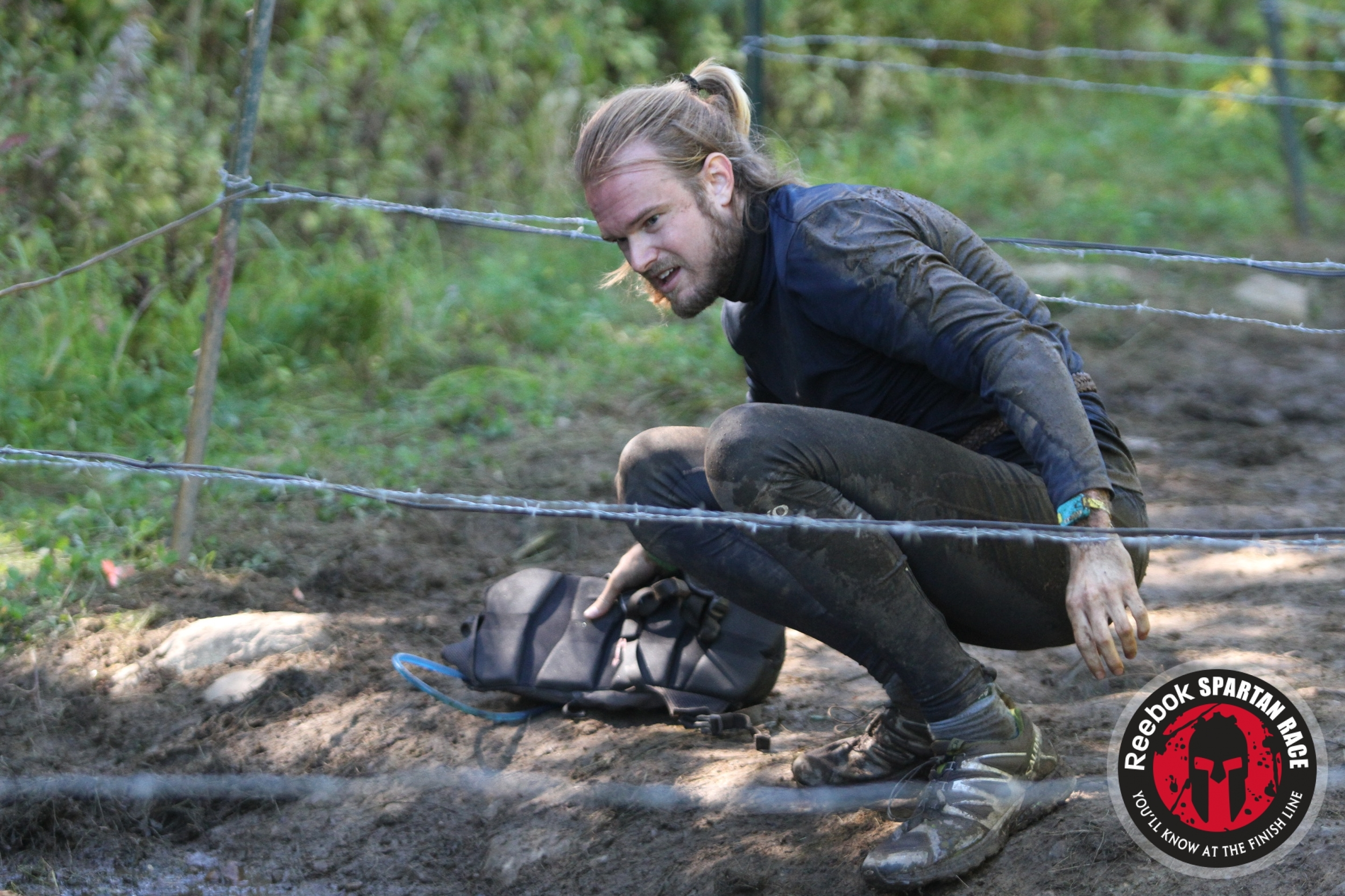 The good ol' barbed wire crawl.  Heidi tied me a wicked man-bun.
