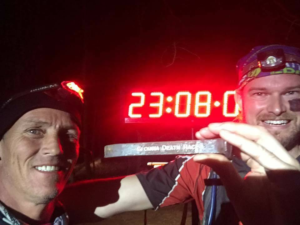 It wasn't pretty, but I did it. My trusted pacer/safety runner Kendall (left) joined me at mile 44.