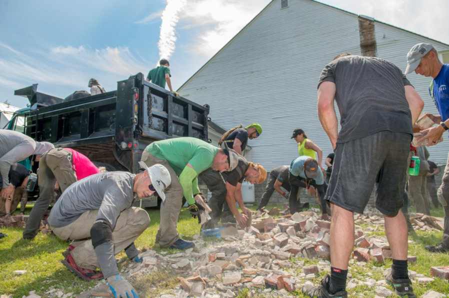 Cleaning up the mass of bricks that littered the ground    Photo Credit:    The Rutland Herald