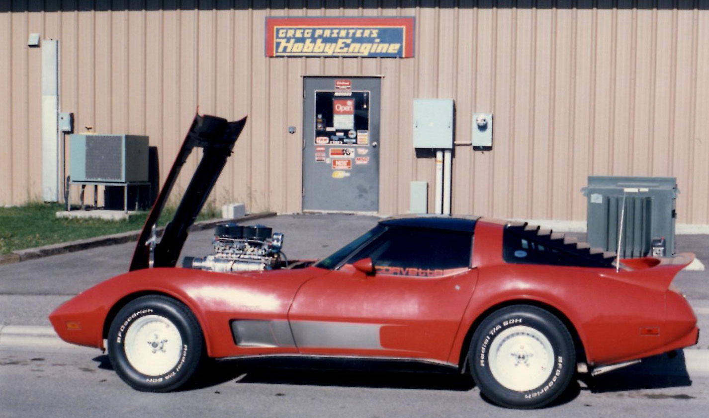 """Greg's supercharged Corvette in front of his first business """"Hobby Engine""""."""