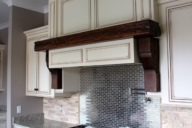 One of our mantels with custom corbels.The wood was from a cabin in Dover, Tennessee that was built in 1816.