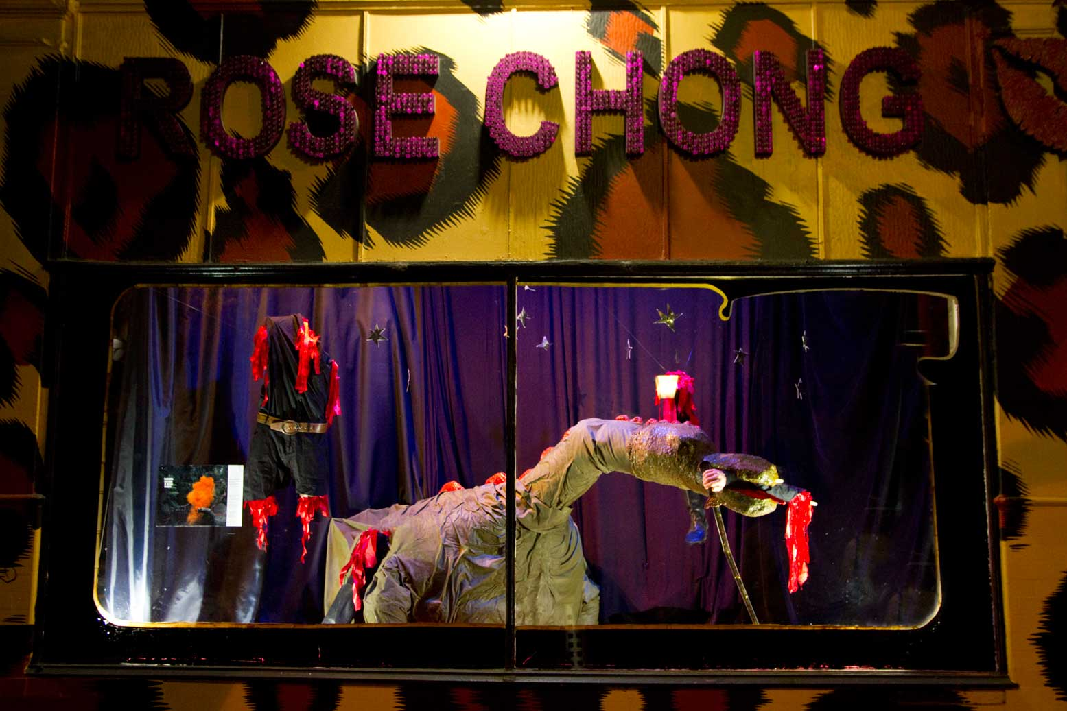 Window display at Rose Chongs Costumiers containing our creation Boris the dragon for the -x ∞ Video
