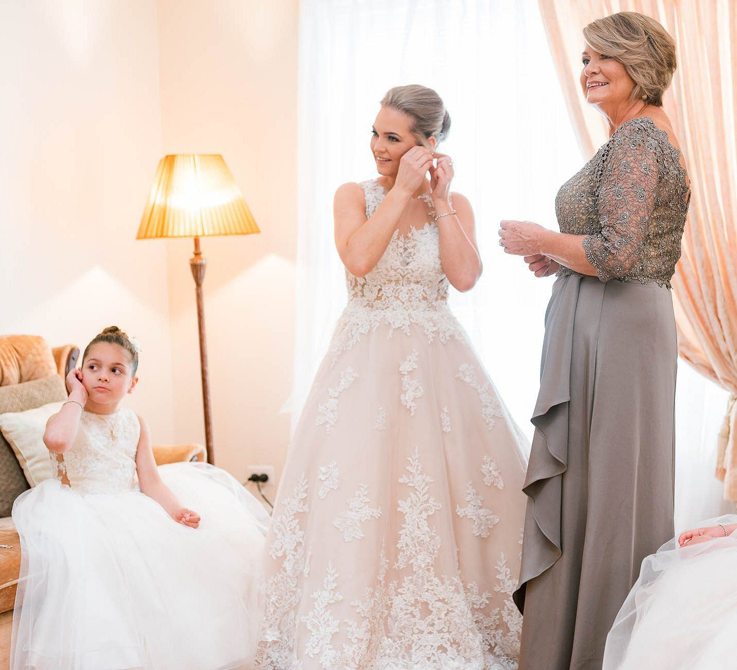 A simple moment - until you realise that this photo has captured 3 generations of the one family. I love the way that our bride Melissa and her daughter are mirroring each other in their movements, with Melissa's mum watching on. And it's all beautifully backlit, giving the photo a soft and intimate feeling.