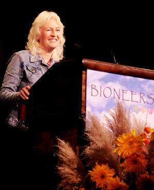 Judy-Wicks-Photo-on-podium-at-Bioneers.jpg