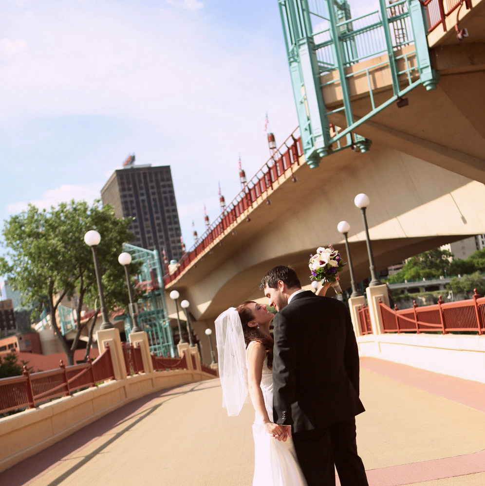 Wedding day portrait of bride & groom at Raspberry Island in St. Paul, MN.