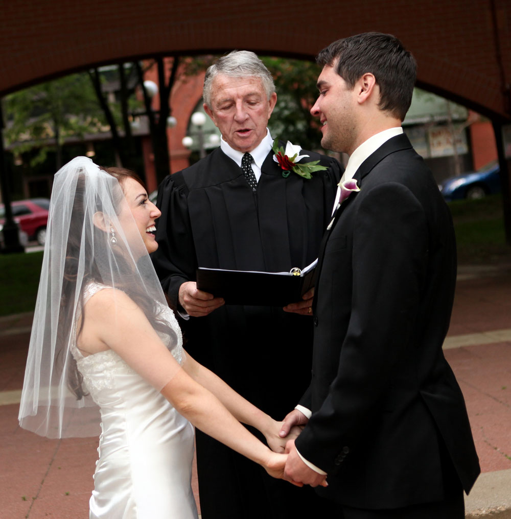 Bride & Groom rejoice during their ceremony at Mear's Park in Lowertown St. Paul, MN.  Officiant: Judge John Cass