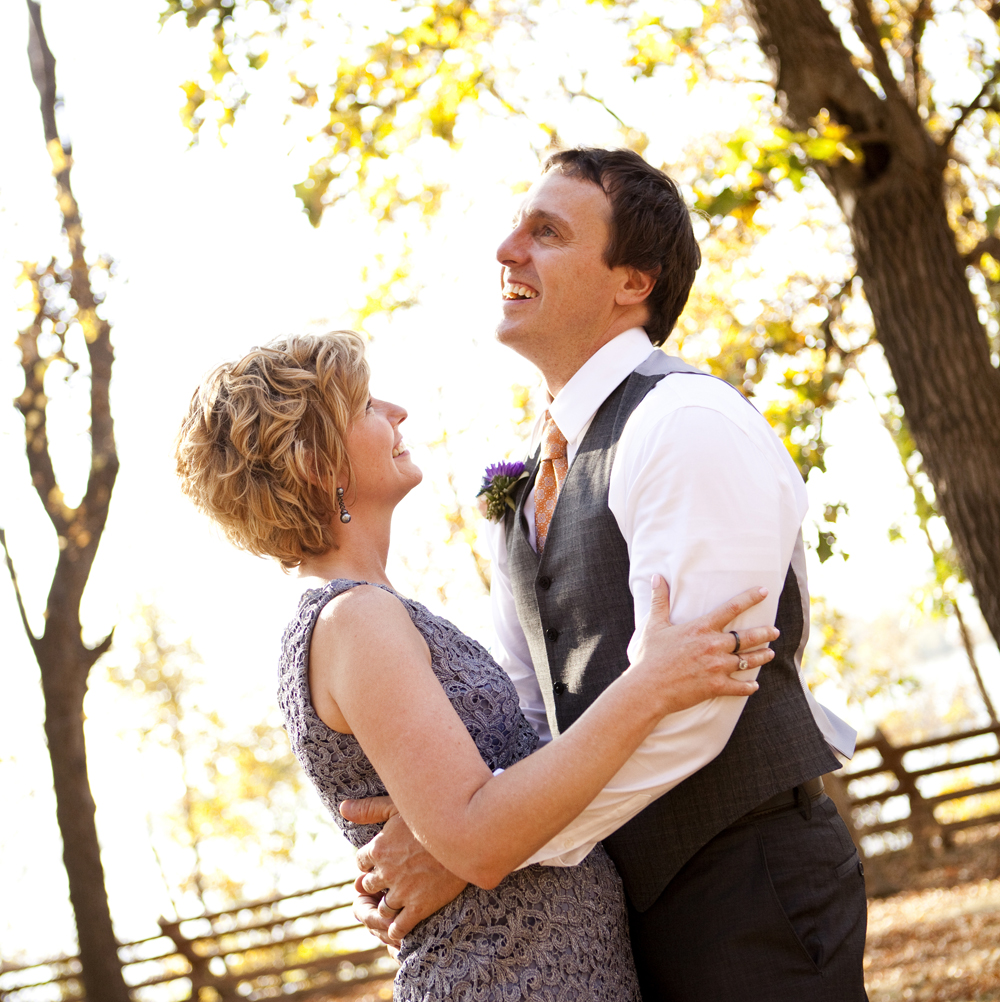 Autumn wedding in Hastings, MN. Bride & groom laughing & smiling. Enjoying the most beautiful indian summer day.