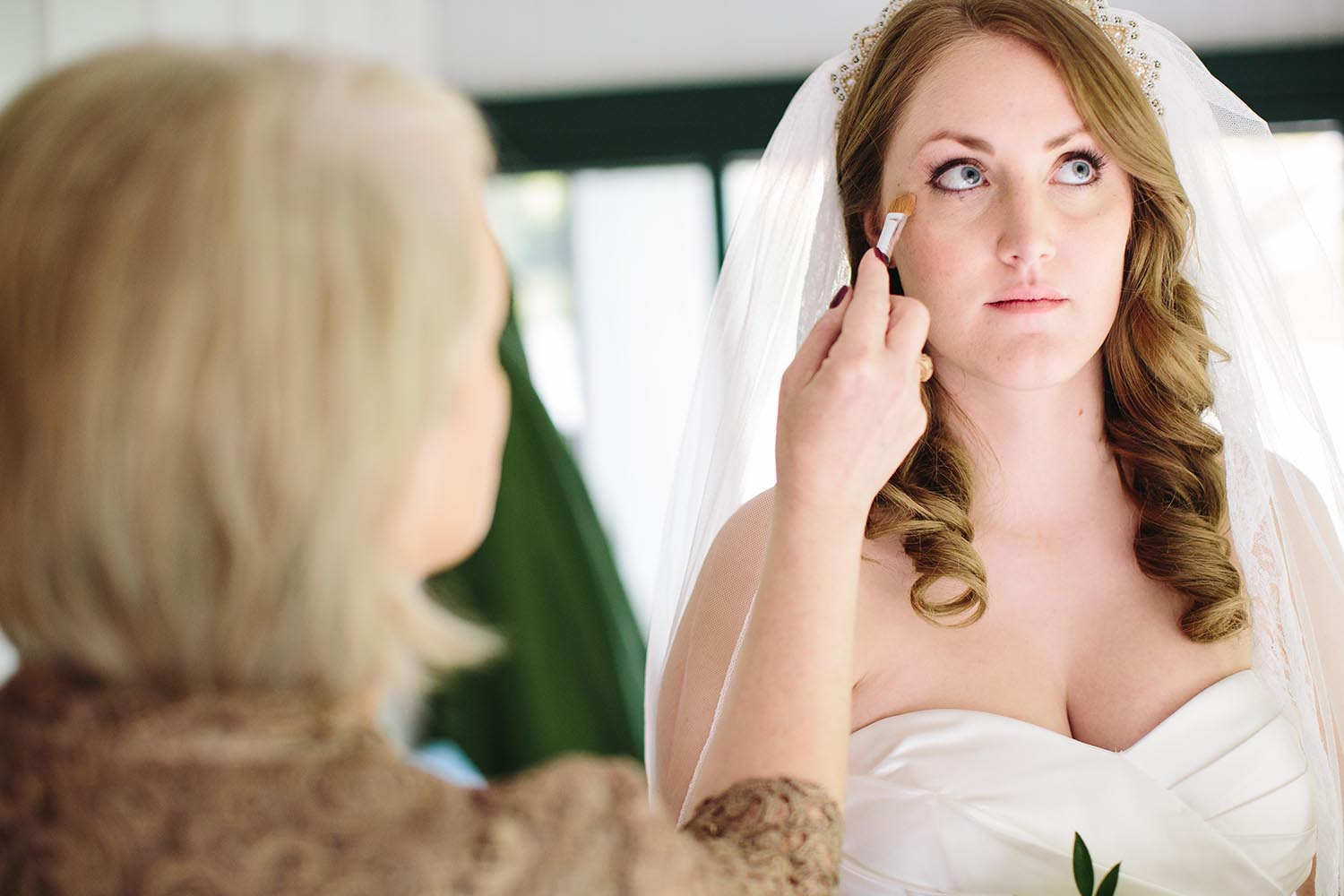bride getting makeup done northern michigan