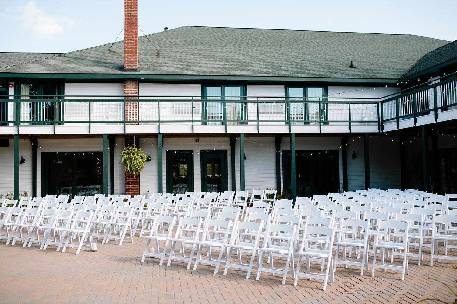 white wedding chairs ready for guests