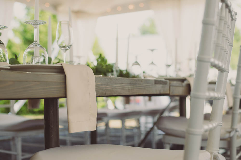 cream napkins and driftwood table