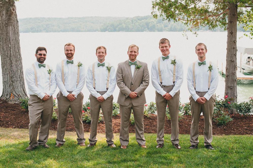 the groomsmen in suspenders and bowties