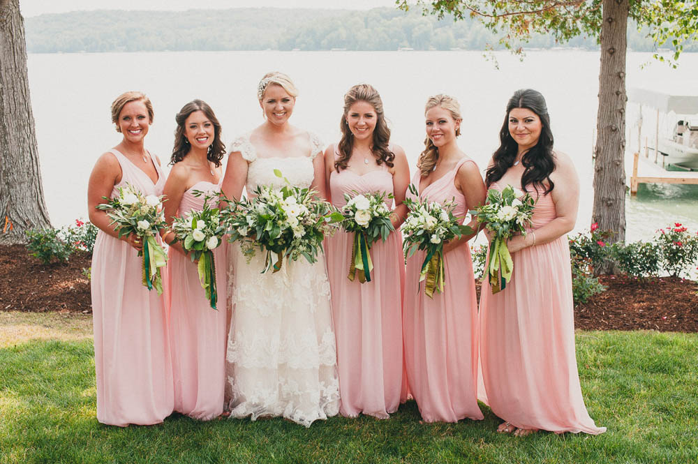 blush pink bridal part at lakeside wedding