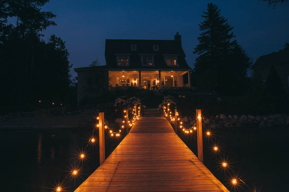 wedding dock at night with cafe lights