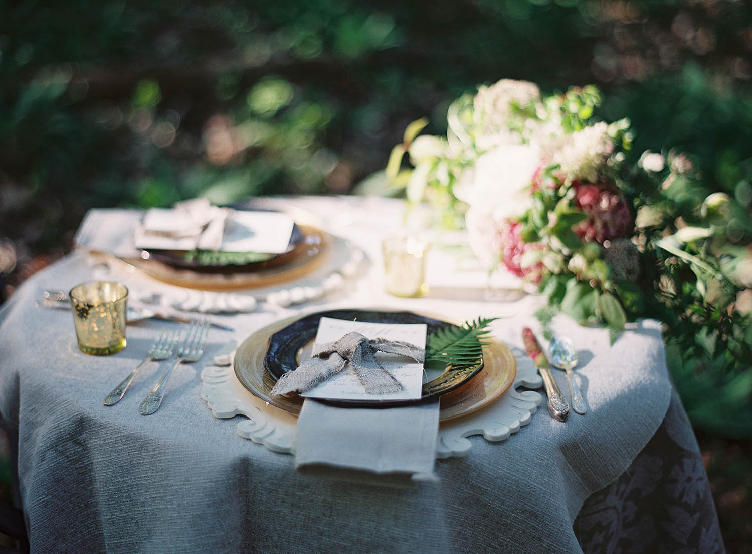 styled linen weddingscape with fern details
