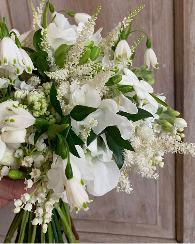This bouquet was the epitome of spring grace and elegance this weekend, second only to our gorgeous bride. @bloomfloraldesign is the master, couldn't help but repost! The lily of the valley and myrtle?! 😍🙌🏻 #perfection #floraldesign #bayharbormi #northernmichiganwedding